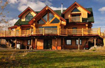 Three levels open concept with high ceilings log home surrounded by wilderness